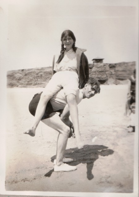 """Evelyn """"Lyn"""" Randell and her brother-in-law Herb Harding at Moana Beach, c.1934"""