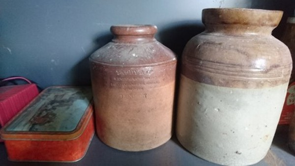 the middle jar is a snuff jar from Taddy & Co. The end one is unmarked.