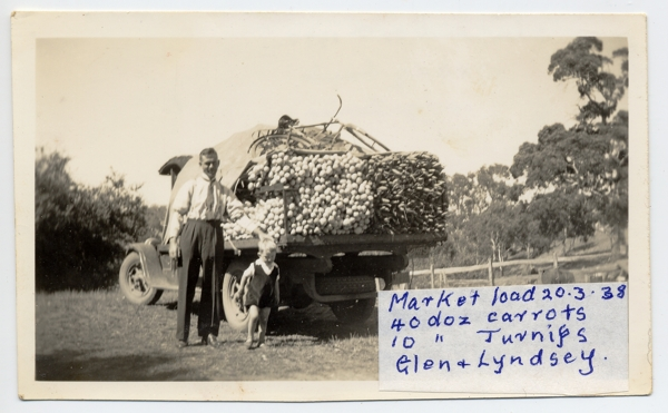 "John Beavis Randell's lorry in 1938, at ""Kenton Park"", Gumeracha loaded for vegetables going to market with his son Glen, and grandson Lyndsey"