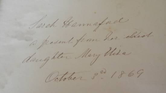 "a close up of the inscription ""Sarah Hannaford, a present from her eldest daughter Mary Eliza, October 3rd 1869"""